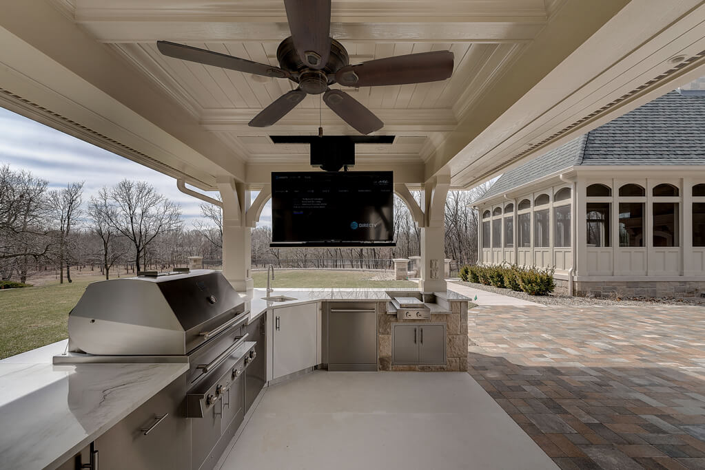 Ennis Custom Homes - Outdoor Kitchens - Carmel, IN Luxury Home Builder - Outdoor Kitchen with TV Down