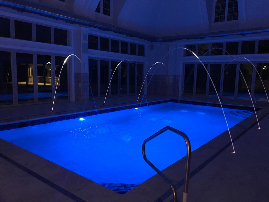 Ennis Custom Homes - Indoor Pool Wing - Exercise Room - Spa Shower - Best Indianapolis Home Builder in Carmel, Indiana - Indoor Pool with Blue Lights