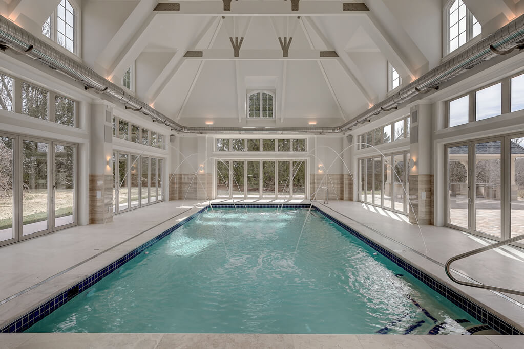 Ennis Custom Homes - Indoor Pool Wing - Exercise Room - Spa Shower - Best Indianapolis Home Builders in Carmel, Indiana - Indoor Pool with Fountains